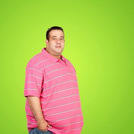 stock photo of morbid  - Happy fat man with pink shirt and a green background - JPG