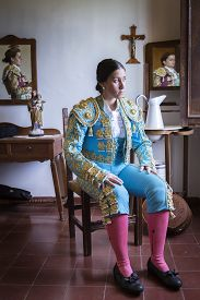 picture of bullfighting  - Woman Bullfighter in hotel room before going to the bullring in Seville - JPG