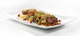 picture of crust  - gourmet meat dish variations cubes of steak grilled breaded flavored crust hazelnut crust with vegetables and fruit on white square plate  - JPG