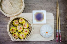 stock photo of steam  - Chinese steamed dimsum and Steamed bun in bamboo - JPG