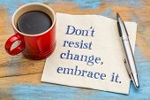 do not resist change, embrace it - motivational phrase on a napkin with a cup of coffee poster