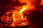 Lava flow pouring into Hawaii ocean at night. Lava falling in ocean waves in Hawaii from Hawaiian Ki poster