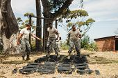 Trainer giving training to military soldiers at boot camp poster