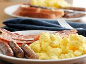 stock photo of scrambled eggs  - breakfast meal with sausage and scrambled eggs with bacon - JPG