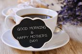 closeup of a black cloud-shaped signboard with the text good morning and happy mothers day written i poster