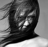stock photo of wind blown  - Nude beauty model in studio with hair blown by wind - JPG