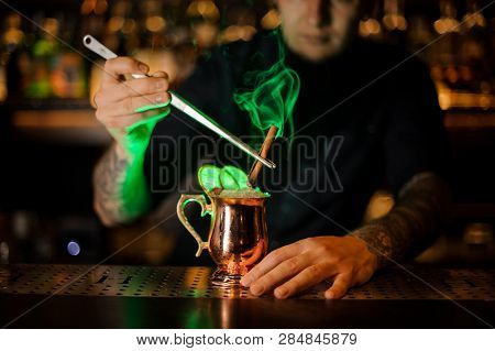 Professional Bartender Adding To A