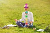 Young Woman With Chakra Points Practicing Zen Yoga On Green Grass poster