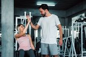 Attractive Fitness Couple Love Giving High Five Together After Workout In Fitness Gym., Portrait Of  poster