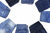 Frame Of Different Blue Jeans Isolated On White Background Top View Flat Lay. Detail Of Nice Blue Je poster