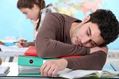 pic of academia  - Young man sleeping during a university lecture - JPG