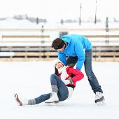 foto of skate  - Ice skating couple having winter fun on ice skates in Old Port - JPG