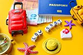 Low Cost Travel Concept With low Cost Message, Biometric Passport Id, Euro, Compass, Miniature Bag poster