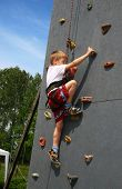stock photo of scrabble  - Boy on climbing wall - JPG