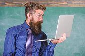 Hipster Teacher Wear Eyeglasses And Necktie Holds Laptop Surfing Internet. Shocking News. Teacher Be poster