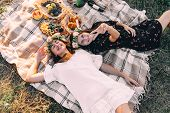 Two Best Friends On Picnic In The Field Laying On The Laid Smiling Top View Friendship Concept poster