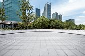 Panoramic Skyline And Modern Business Office Buildings With Empty Road,empty Concrete Square Floor poster