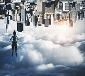 Confident Hakcer Standing On Abstract Upside Down City Background With Clouds And Copy Space. Malwar poster