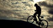 Silhouette of Mountain bike.Sport and healthy life.Extreme sports.Mountain bicycle and man.Life styl poster