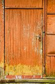 Very Old Weathered Orange Door Of Old Abandoned Building, Texture poster