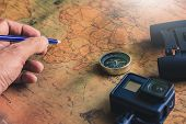 Man Writing Notepad For Note With Binoculars Pencil, Compass On Paper Map For Travel Adventure Disco poster