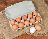 Top View Of Brown Chicken Eggs In Open Paper Pulp Carton For Ten Eggs, Brown And White Eggs Beside T poster