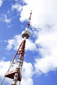 High Metal Tower Used For Broadcasting With Clouds On Background. Tower With Antennas In The Blue Sk poster