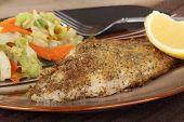 stock photo of catfish  - Fried catfish fish fillet with lemon slice - JPG