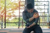 Handsome Fitness Man Has Perfect Body Feeling Pain In His Shoulder During At The Gym, Healthy Man Sh poster