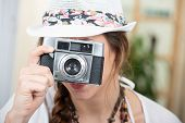 Beautiful Hippie Woman With A Vintage Camera And Summer Hat poster