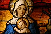 stock photo of stained glass  - Stained glass depicting the Virgin Mary holding baby Jesus - JPG