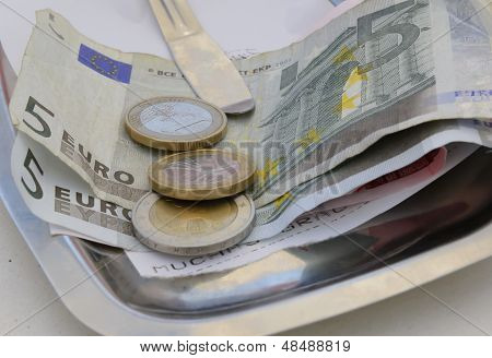 Euro bills and coins on