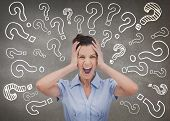 foto of anger  - Elegant businesswoman screaming and holding her head - JPG