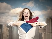 stock photo of superhero  - woman opening her shirt like a superhero - JPG