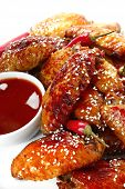 pic of chicken wings  - Chicken wings cooked with honey and soy served with a chili dipping sauce and topped with sesame seeds - JPG