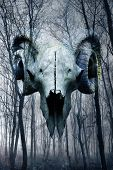 foto of occult  - Demonic occult goat skull materialising in misty atmospheric haunted forest - JPG
