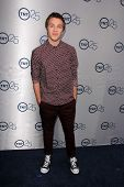 LOS ANGELES - JUL 24:  Connor Jessup arrives at TNT's 25th Anniversary Party at the Beverly Hilton H
