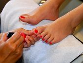 image of toe nail  - woman getting her feet done at a nail salon - JPG