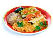 stock photo of mexican food  - A colorful Mexican food plate with tacos bean and rice - JPG