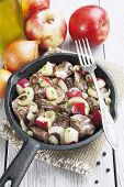 stock photo of liver fry  - Chicken liver stewed with apples and onion in the frying pan - JPG