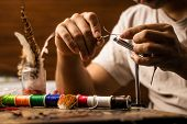 picture of thread-making  - Close Up On Young Man - JPG