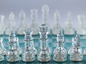 Glass Chess Pieces On A Frosted Glass Chessboard