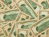 A Pile Of Ten Dollar Bills As A Money Background