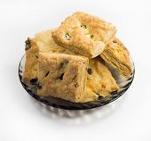 foto of baked raisin cookies  - Cookies with cherry and raisin on a round dish - JPG