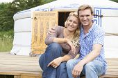 foto of yurt  - Couple Enjoying Camping Holiday In Traditional Yurt - JPG