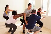 picture of middle class  - Fitness Instructor In Exercise Class For Overweight People - JPG