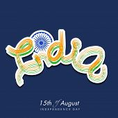 picture of indian independence day  - Stylish text India in national flag colors and ashoka wheel on blue background for Indian Independence Day celebrations - JPG