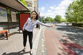 foto of hail  - Full length beautiful businesswoman hailing taxi on street - JPG