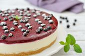 image of cheesecake  - Black currant cheesecake with fresh berries on plate closeup