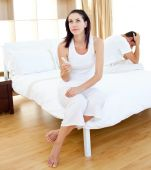 stock photo of pregnancy test  - Pensive couple finding out results of a pregnancy test in the bedroom - JPG